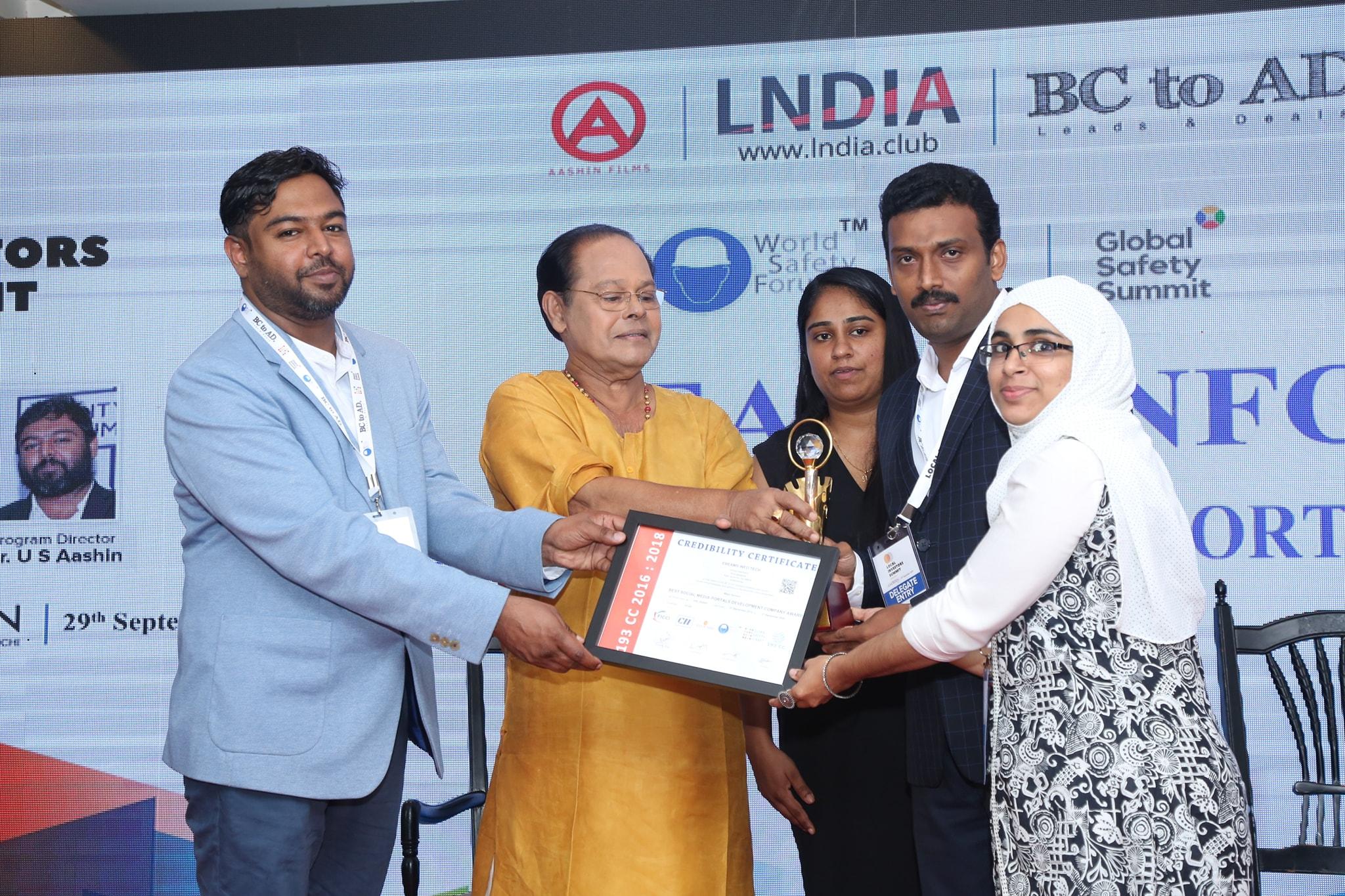 eBeams Directors NasemKhan and Raseena are Receiving Award from Actor Innocent